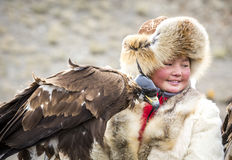 Eagle huntress with her Altai Golden Eagle. Bayan Ulgii, Mongolia, October 4th, 2015: Eagle huntress  with her Altai Golden Eagle Stock Images