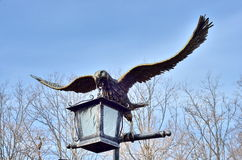 Eagle  with lantern Bronze statue. Garden decorations.Eagle Bronze statue Royalty Free Stock Photos