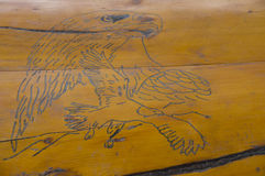 Eagle Line Sketch. On log planks with light stained background. Eagle head and eagle in flight Royalty Free Stock Photography