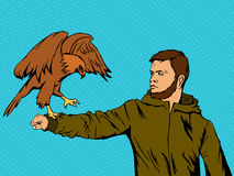 Eagle on a man`s hand Stock Photo