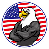 Eagle mascot show the muscle with american flag background Royalty Free Stock Image
