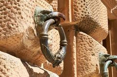 Eagle with metal ring in beak, Architectural detail. Alhambra Stock Photos