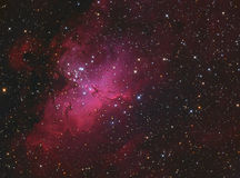 The Eagle Nebula M16 in Serpens. The Eagle Nebula (Messier 16 or M16, and as NGC 6611) is a young open cluster of stars and nebula in the constellation Serpens stock photos