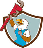 Eagle Plumber Raising Up Pipe Wrench Crest Cartoon Royalty Free Stock Photos