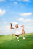Eagle Putt. Golfer lines up his eagle putt Royalty Free Stock Image