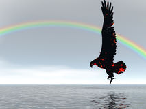 Eagle Rainbow. Eagle descending with rainbow in background Royalty Free Stock Photo