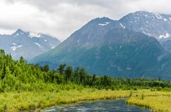 Alaska`s Slow Moving Eagle River and Chugach Mountains royalty free stock image