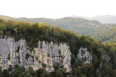 Eagle Rocks, Krasnodar Territory. Absolutely vertical cliffs covered with light limestone and yellow sandstone. On their tops grow royalty free stock photos