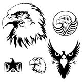 Eagle set. Set of heraldry realistic eagle head and symbol design elements, black colored Stock Image
