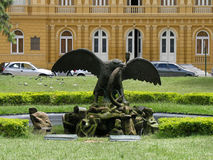 Eagle and snake statue. Statue of an eagle with wings outstretched fighting a snake stock photo