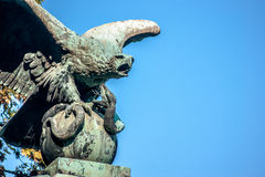 The eagle and the snake. Statue of eagle eating a snake, symbol of the city of Mexico Stock Photo