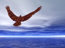 Eagle Soaring. Through blue and cloudy skies Royalty Free Stock Image