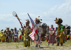 The Eagle Staff leads the Grand Entry at he NYC  Pow Wow in Brooklyn Stock Image