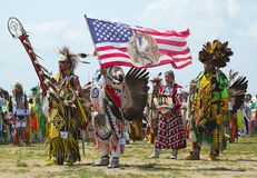 The Eagle Staff leads the Grand Entry at he NYC Pow Wow in Brooklyn Royalty Free Stock Photo
