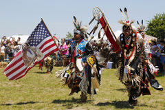 The Eagle Staff leads the Grand Entry at the NYC Pow Wow Stock Image