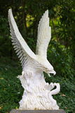 Eagle. A Stone sculpture of an Eagle flighting a snake Royalty Free Stock Photography
