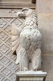 The eagle symbol of St. John the Evangelist, statue on the facade of Saint Augustine church in Paris