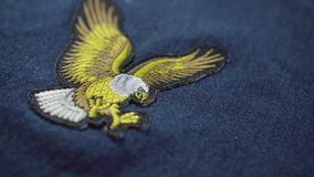 Eagle symbol on top of jeans. After stitch. symbol of america. Independence day stock footage