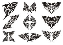 Eagle symbols in tribal style. Black on the white Stock Image