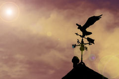 Eagle weather vane. On a beautiful sky royalty free stock photo