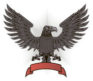 Eagle with wings and red ribbon Stock Photos