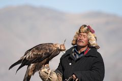 Eaglehunter with golden eagle Stock Photos