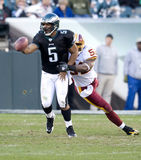 Eagles. Quarterback Donovan McNabb passes as Redskins Rocky McIntosh pressure him in the third quarter. 11/29/2009 Royalty Free Stock Images