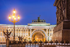 Eagles and Horses. Eagles on a lattice the Alexander Column on Palace Square in St. Petersburg and horses over the arch of the Staff Stock Photo