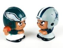 Eagles v. Cowboys Li`l Teammates Toy Figures. Eagles v. Cowboys, Li`l Teammates Toy figures on a white backdrop royalty free stock image