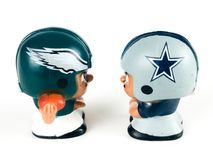 Eagles vs. CowboysLi`l Teammates Toy Figures. Eagles vs Cowboys, Li`lToy figures on a white backdrop Stock Image