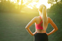 Ealthy sports lifestyle. Athletic young woman in sports dress doing fitness exercise. Fitness woman. Stock Photography