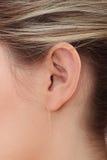 Ear. Young caucasian woman ear closeup stock photos