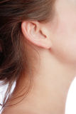 Ear. Close-up shot of young woman's neck and ear Stock Photos
