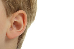 The ear. Close-up of a child's ear, isolated on a white background Royalty Free Stock Images