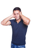 Ear ache. Young man suffering from ear ache Stock Photo