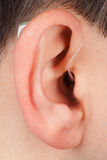 Ear with acoustic instrument Stock Photo