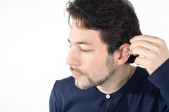 Ear with acoustic instrument Royalty Free Stock Image