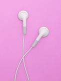 Ear buds. On a pink bg Royalty Free Stock Image