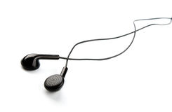 Ear buds. Black ear buds isolated on white background Royalty Free Stock Image