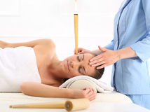 Ear candling, natural purifying treatment