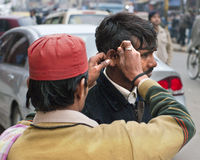 Ear cleaning on the streets of India Stock Photo