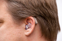 Ear close up with hearing aid Stock Image