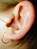 Ear Closeup. Woman's Ear Closeup in Color Stock Photos