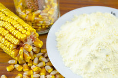 Ear of corn and a plate of flour Royalty Free Stock Images