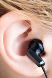 Ear with Earbud Stock Images