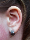 Ear with earring Stock Image