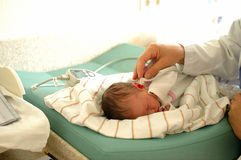 Ear examination. Babys ear under examination royalty free stock image