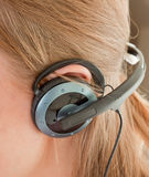 Ear with headphones Stock Photos