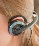 Ear with headphones Stock Photos