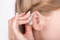 Ear with hearing aid Royalty Free Stock Photos